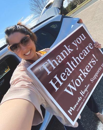 Alexandra Strand delivering signs in Menomonie