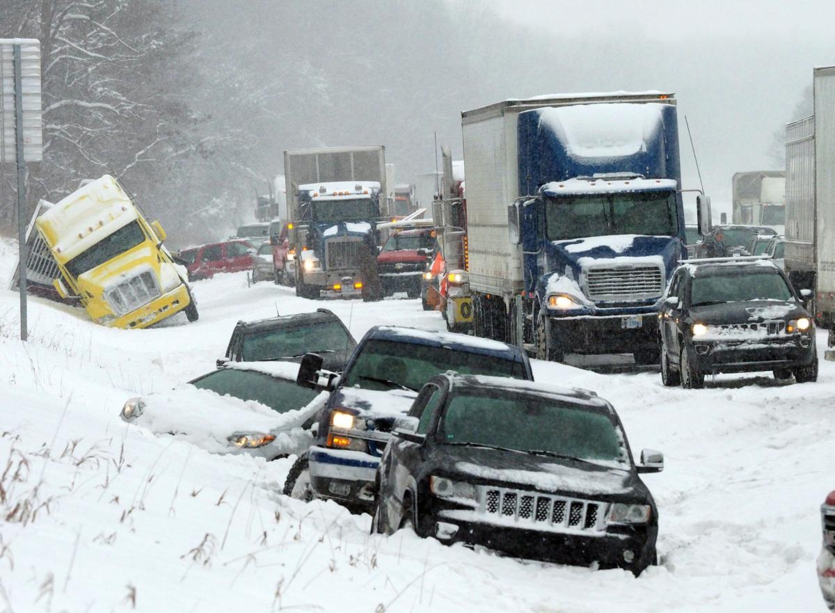 Midwest storm blamed for 2 deaths, crashes, school closings, flight