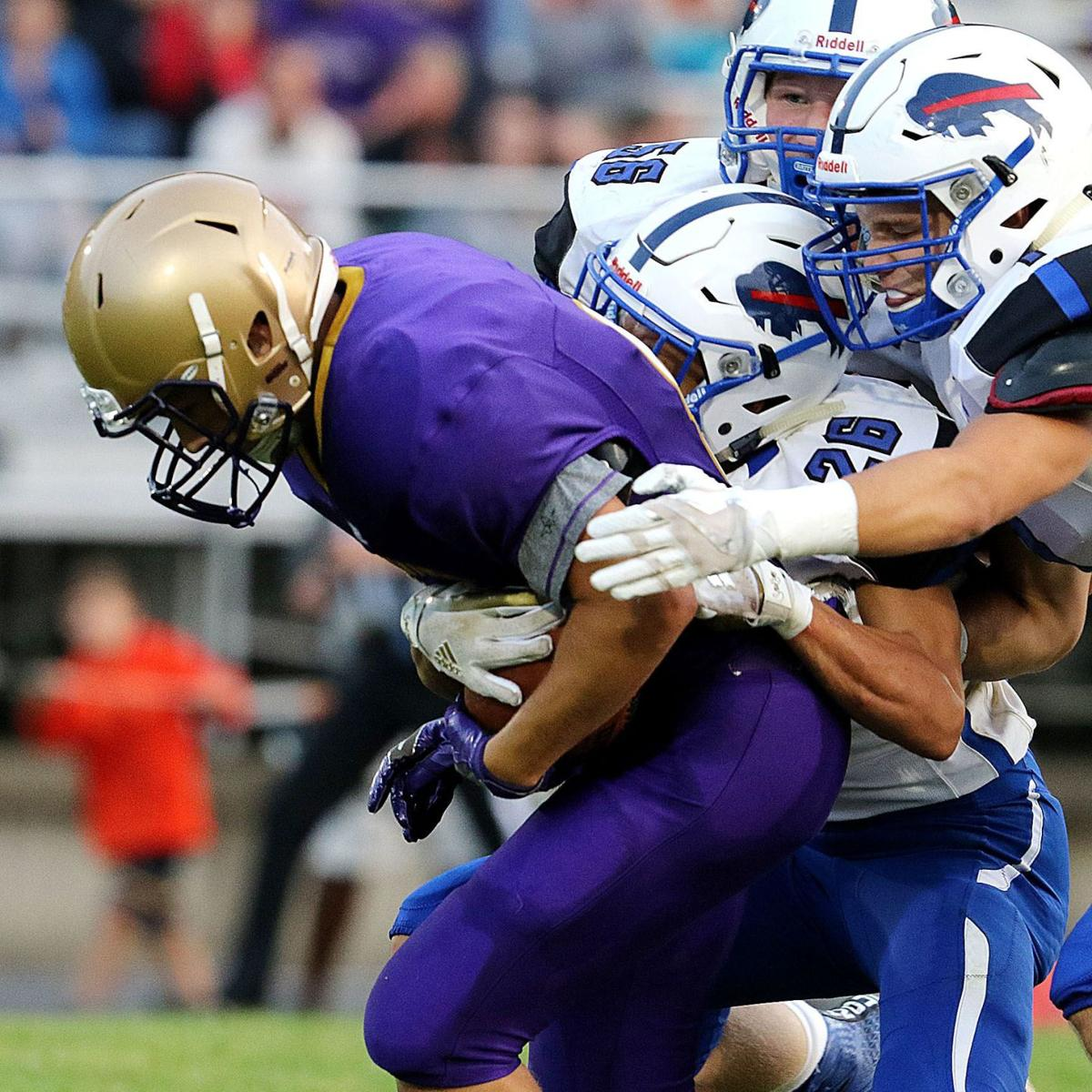 Prep football: Conference realignment plan leaves some area