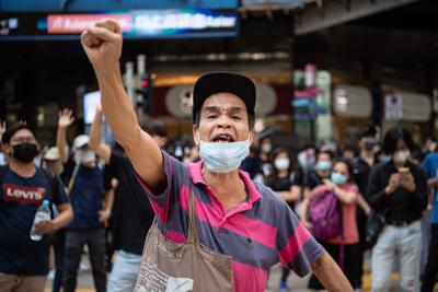 People protest a government ban on face masks in Central on October 4, 2019 in Hong Kong, China.
