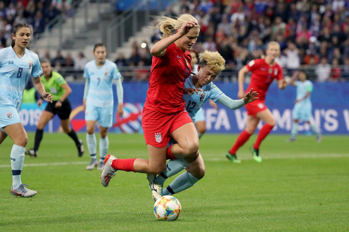 Lindsey Horan of the USA is challenged by Rattikan Thongsombut of Thailand inside the penalty area during the 2019 FIFA Women's World Cup France group F match between USA and Thailand at Stade Auguste Delaune on June 11, 2019 in Reims, France.