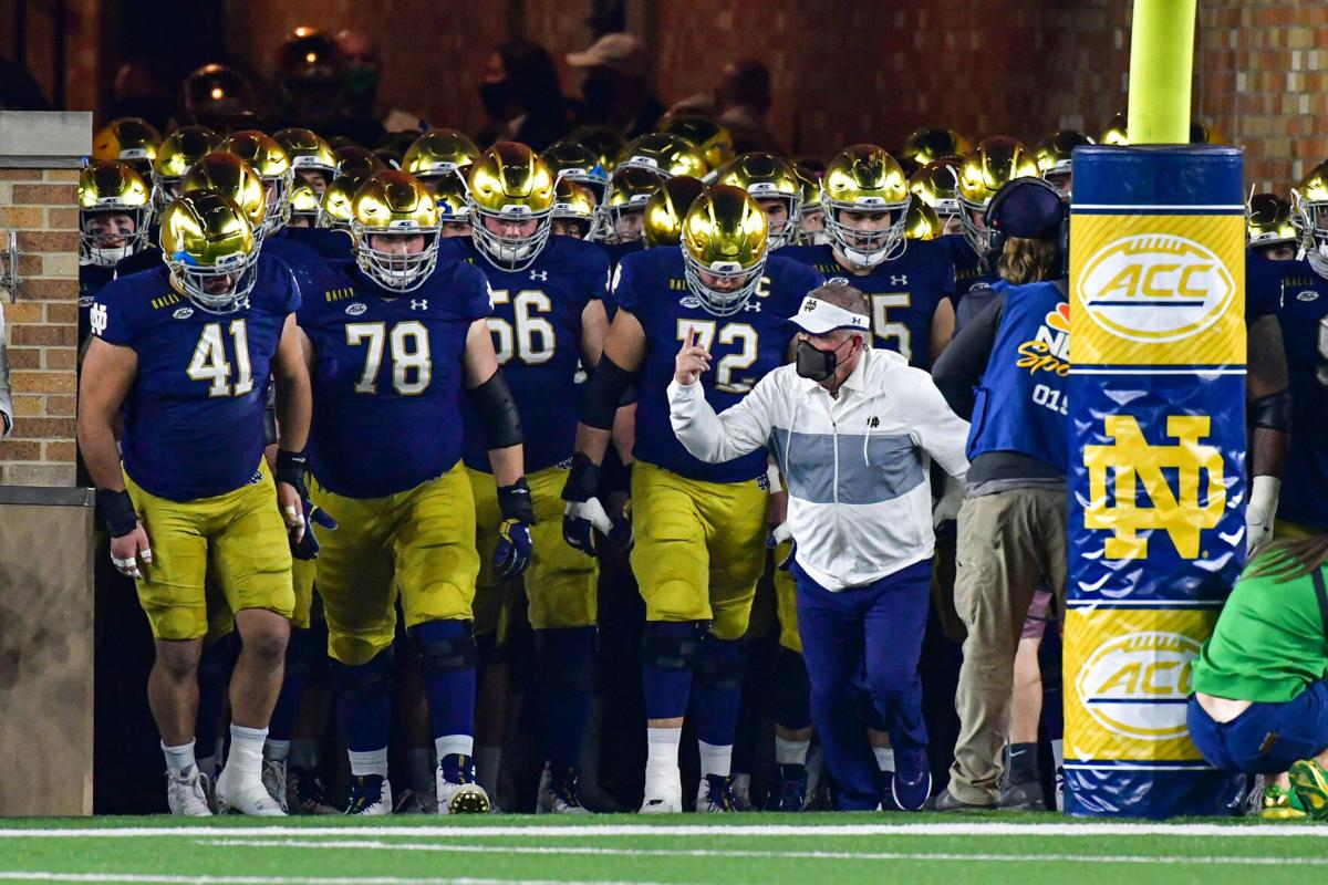 Notre Dame head coach Brian Kelly leads his team out of the tunnel before a game against Clemson at Notre Dame Stadium on Nov. 7, 2020, in South Bend, Indiana.