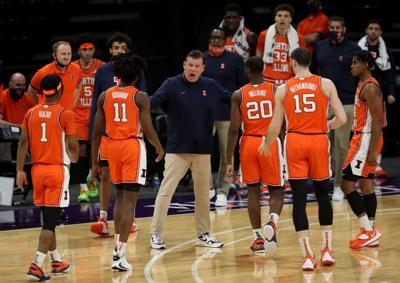 Illinois coach Brad Underwood talks with his players in the first half against Northwestern on January 7, 2021, at Welsh- Ryan Arena in Evanston, Illinois.