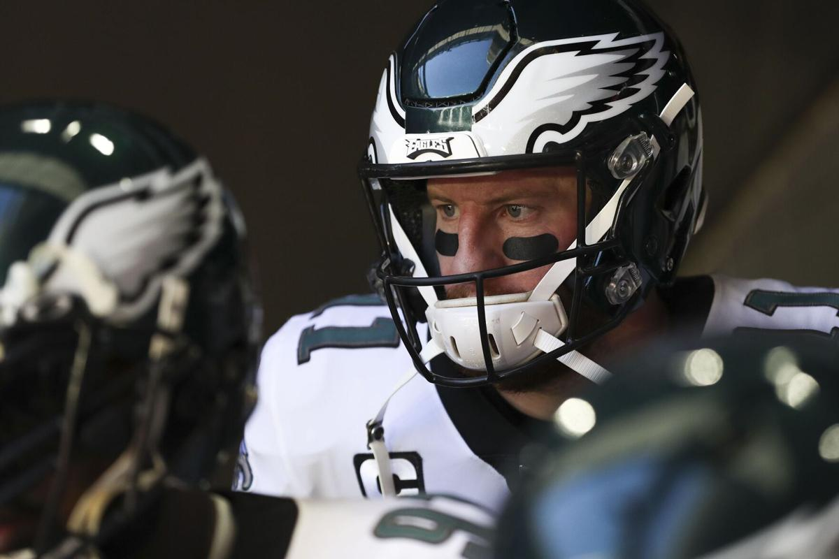 Philadelphia Eagles quarterback Carson Wentz stands in the tunnel before taking on the Arizona Cardinals at State Farm Stadium in Glendale, Ariz. on Sunday, Dec. 20, 2020.