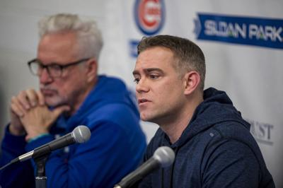 Chicago Cubs manager Joe Maddon, left, and team president Theo Epstein speak on February 12, 2019, as the team reports to spring training in Mesa, Ariz.