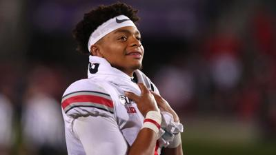 Ohio State quarterback Justin Fields looks on from the bench in the third quarter against Northwestern on Oct. 18, 2019, in Evanston.