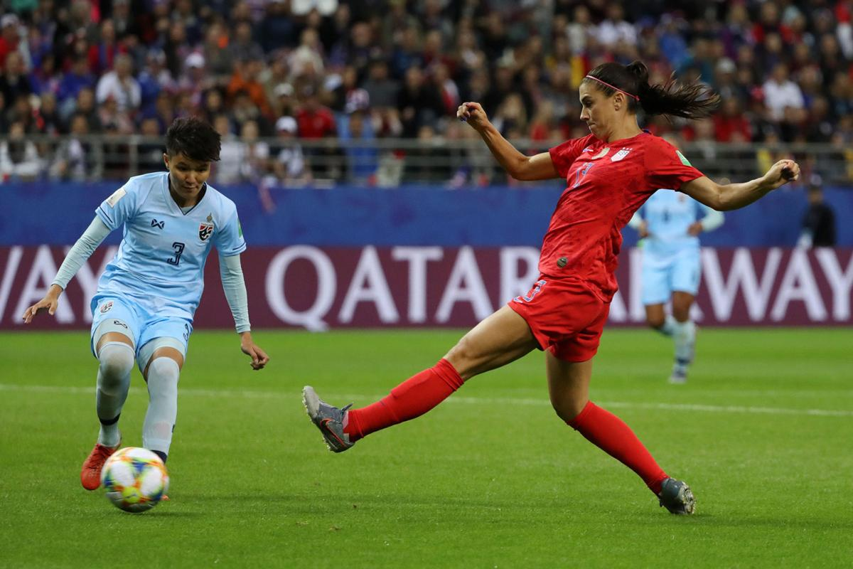 Alex Morgan of the USA, right, is challenged by Natthakarn Chinwong of Thailand during the 2019 FIFA Women's World Cup France group F match between USA and Thailand at Stade Auguste Delaune on June 11, 2019 in Reims, France.