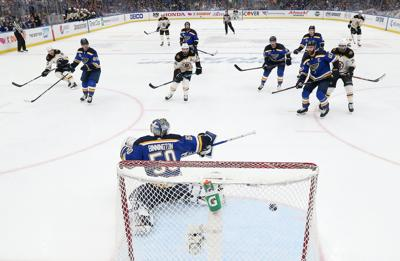 Jordan Binnington (50) of the St. Louis Blues allows a third period goal to Karson Kuhlman (83) of the Boston Bruins in Game Six of the 2019 NHL Stanley Cup Final on Sunday, June 9, 2019 at Enterprise Center in St Louis, Mo. (Bruce Bennett/Getty Images/TNS)  **FOR USE WITH THIS STORY ONLY**