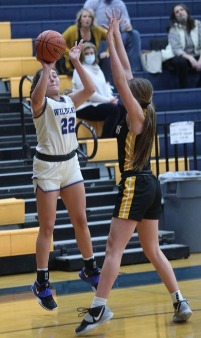 Lady 'Cats fight back, but fall in OT