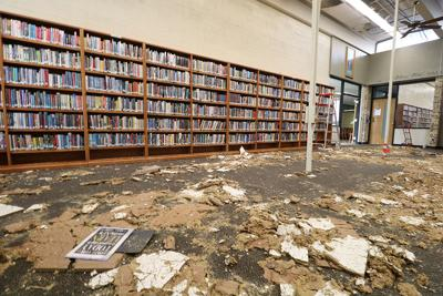 Extensive water damage to Cozad High School library after roof was damaged during the storm