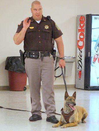 Tika and her handler, Sgt. Tucker Case