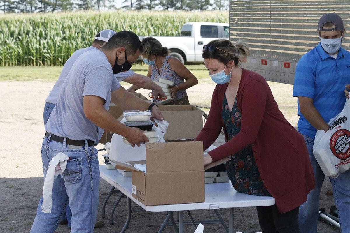 Volunteers brave COVID-19 pandemic and the heat to distribute food to community