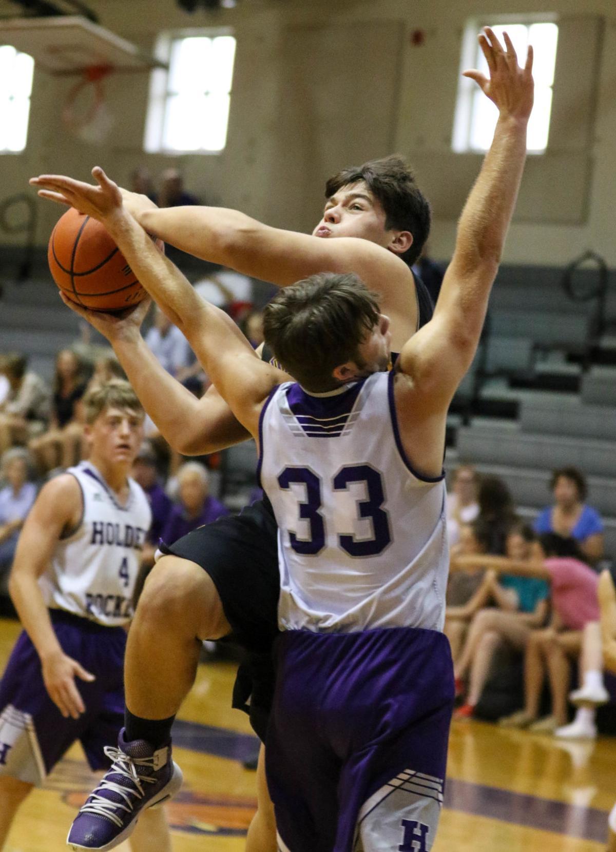 Doyle summer basketball vs. Holden: Nathan Raymond (33) , Doyle's Tyson Stewart (32)