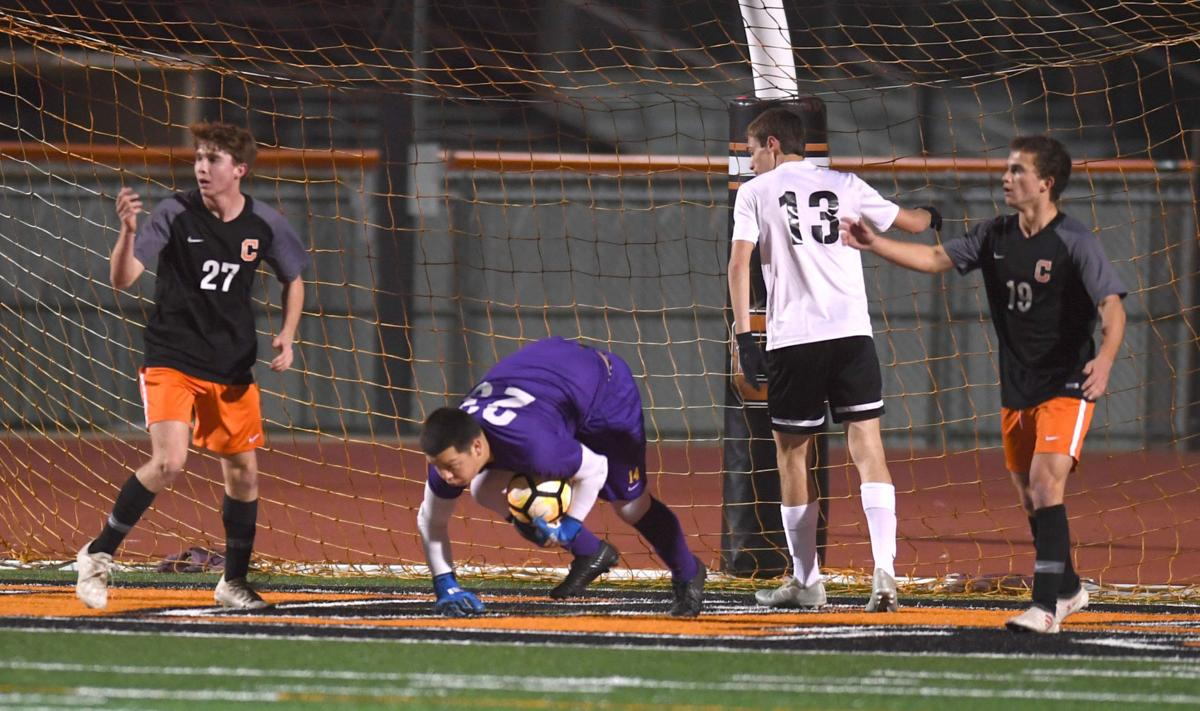 DSHS' keeper Jose Ortega comes up with save. Also pictured for Jackets is Austin Scott (13) vs. Catholic.jpg