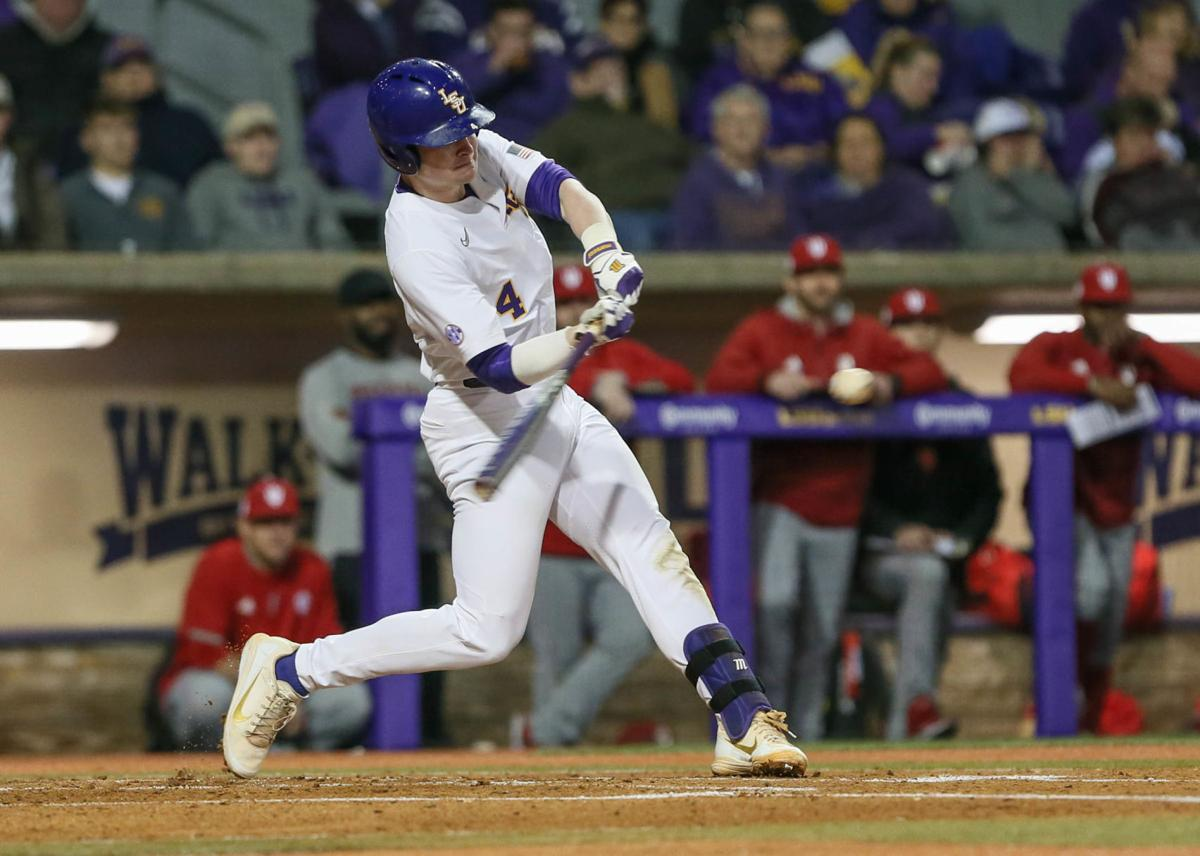 LSU freshman second baseman Cade Doughty follows through on what would be his first career home run in the bottom of the first inning..jpg