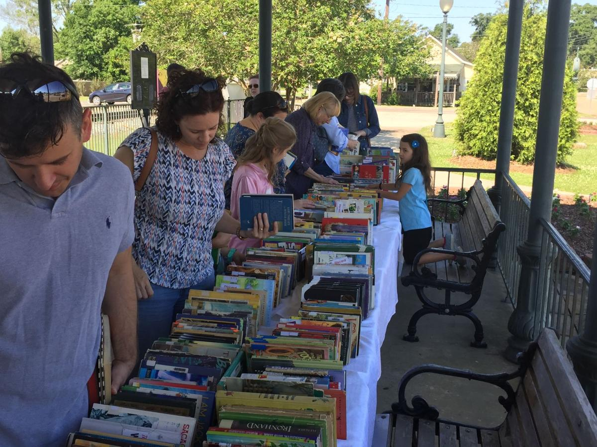 Book lovers gather at train station park for lost library for Table 52 chicago closing
