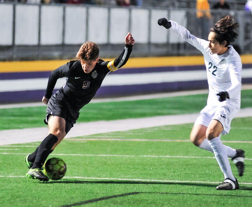 Denham Springs soccer vs. Grace King: Will Chevalier (9) around a Grace King defender