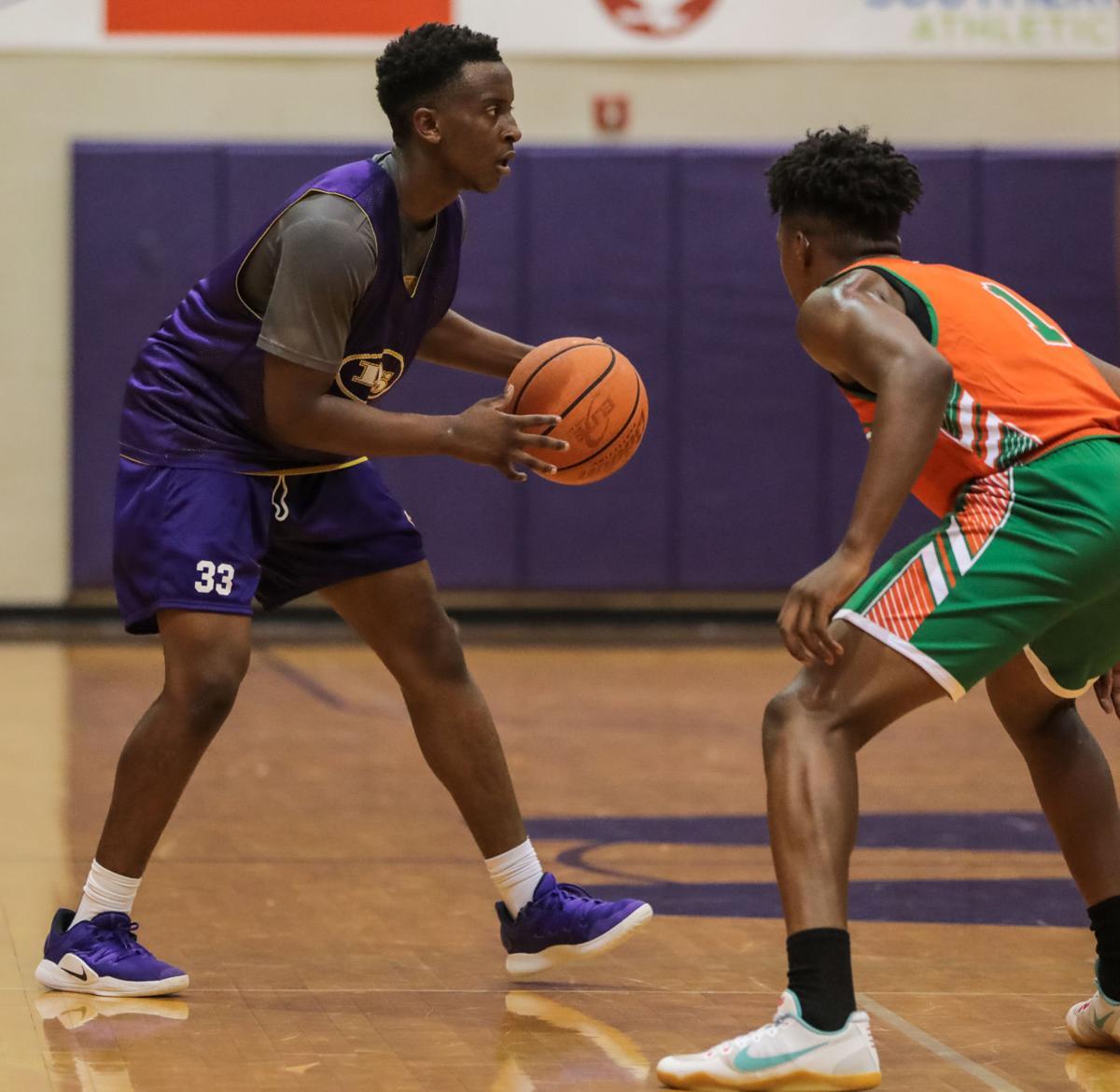 Central vs. Denham Springs basketball C.J. Johnson Nah'Landri Stimson