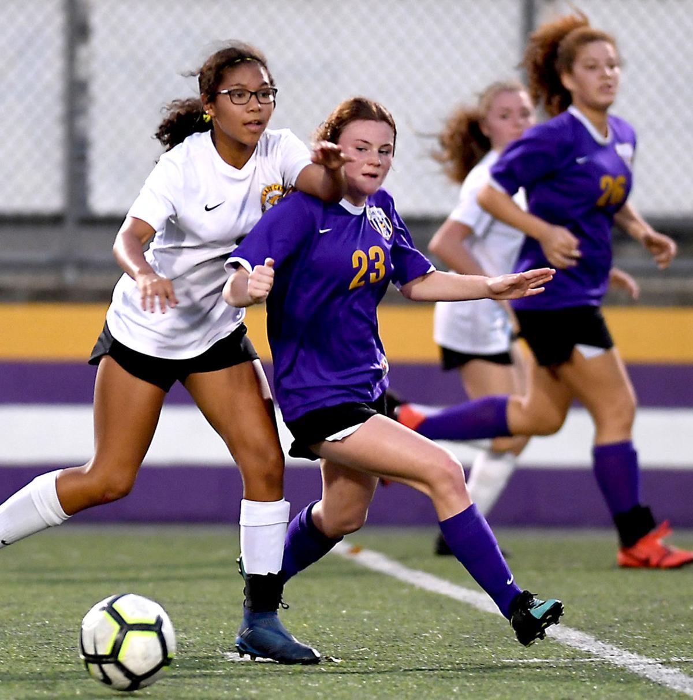 DSHS vs. Walker girls soccer: Emily Ellis (23), Walker's Jordyn Brooks (2)