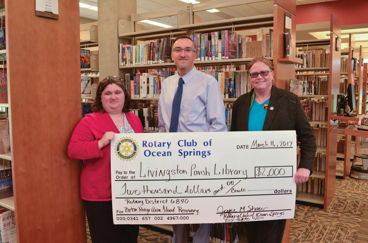 Rotary Club of Ocean Springs makes donation to Livingston Parish Library