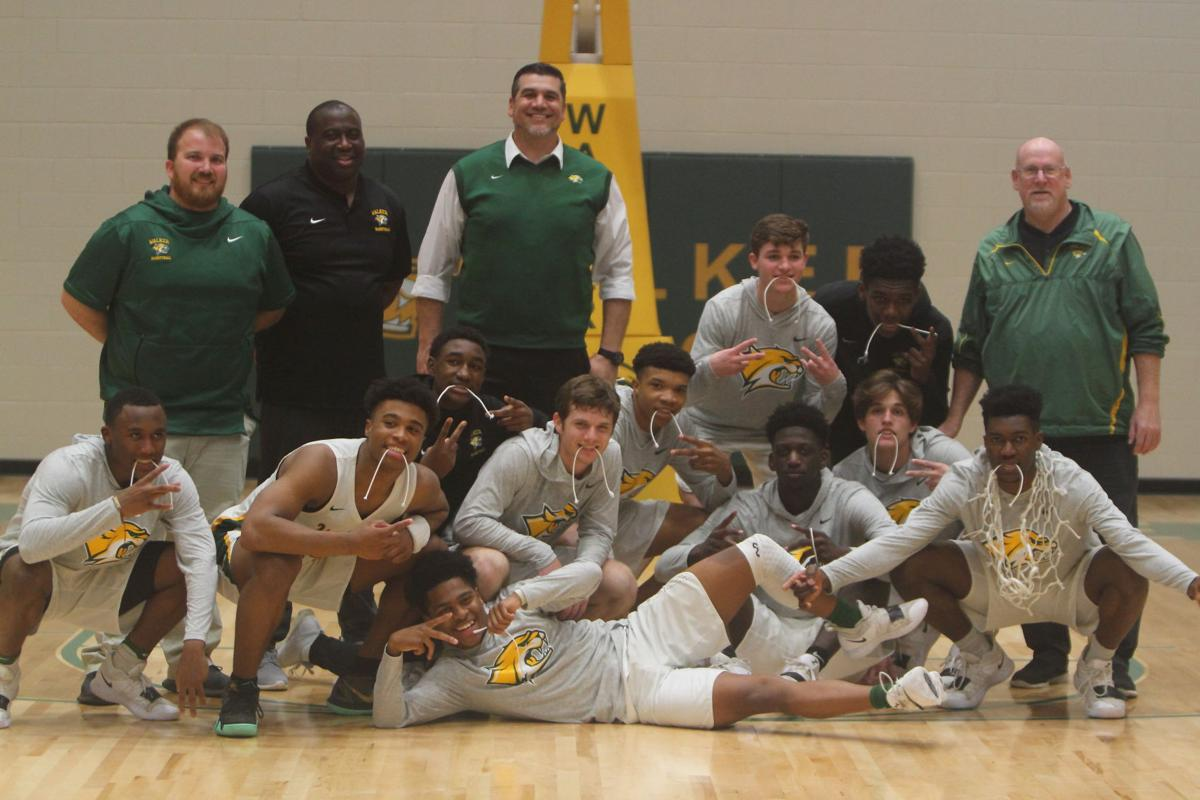 Walker boys basketball vs. Landry-Walker: Team celebration