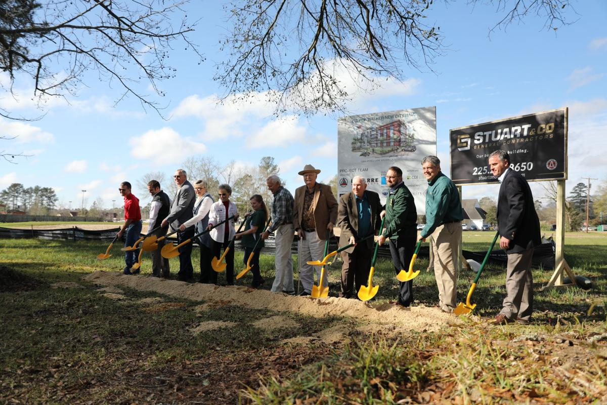 Walker breaks ground on new city hall