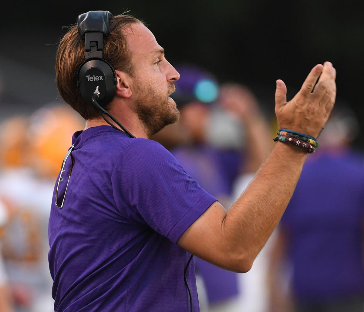 Denham Springs coach Bill Conides signals in a play from the sideline..jpg