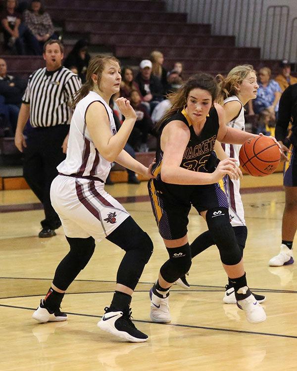 Albany vs Denham Springs girls K. Thompson(32) Kellie Landry(1)