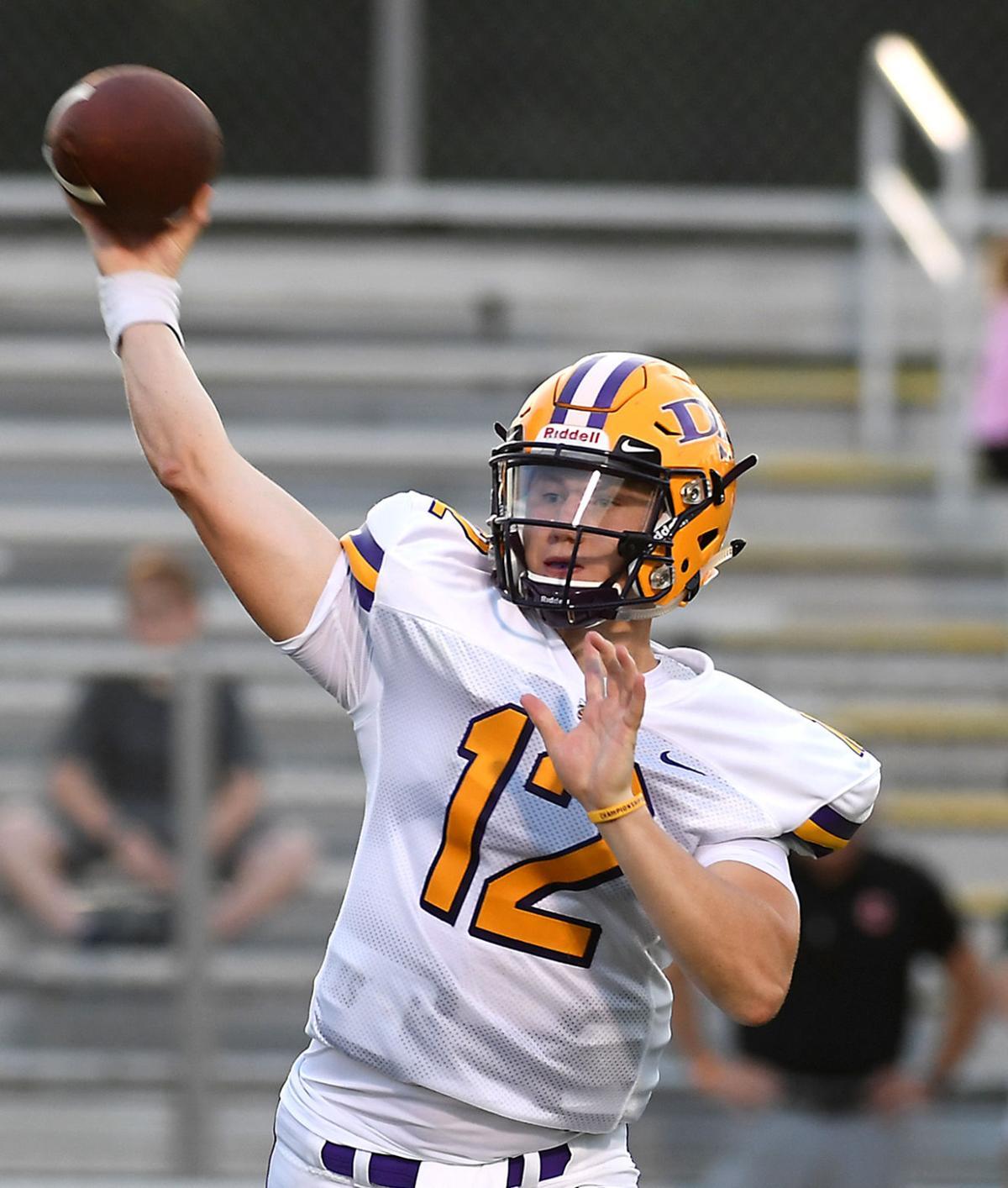 Denham Springs quarterback Luke Lunsford (12) looks for room down field to deliver a pass..jpg