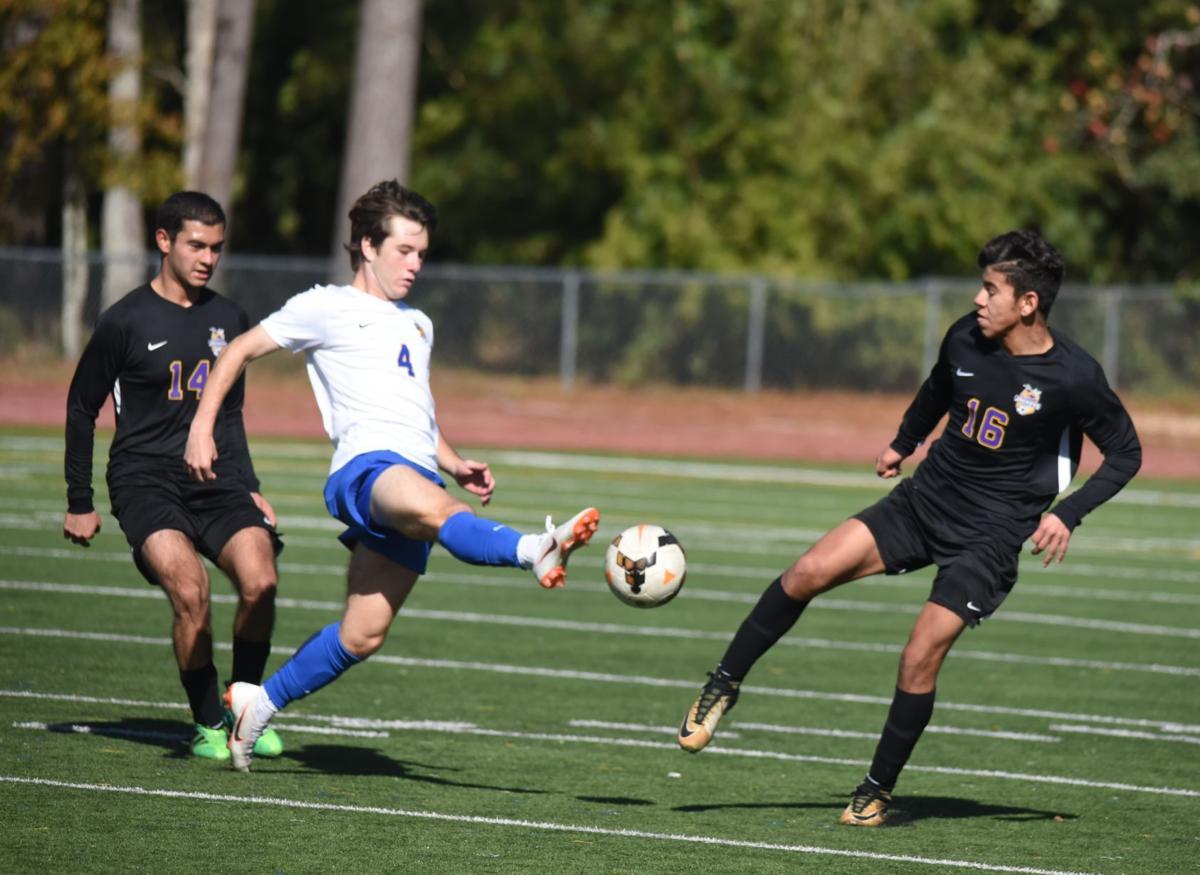 DSHS' Bryan Lagos (14) and Axel Aguccia (16) defend.JPG