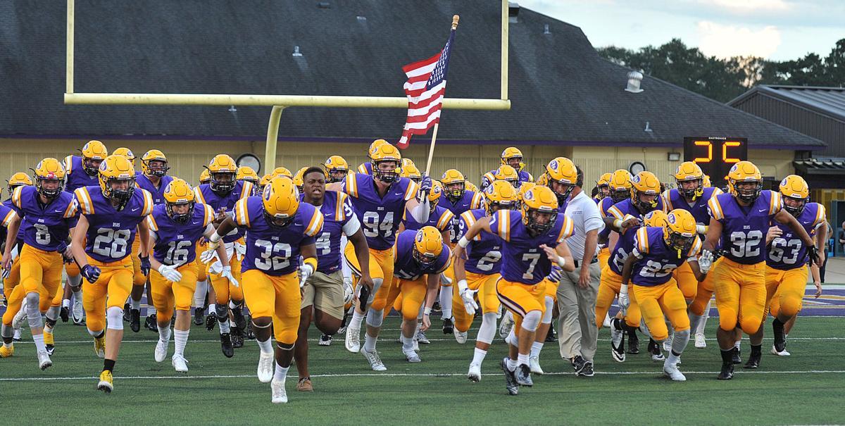 DSHS football team shot with flag