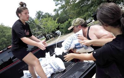 Loading sandbags in Denham Springs