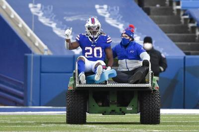 Bills sign RB Freeman to practice squad, place Moss on IR