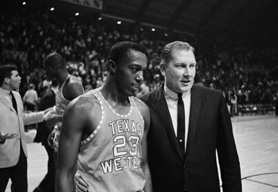 2d716b68795 Texas Western coach Don Haskins, right, escorts Orsten Artis off the court  after Texas Western defeated Utah in a semifinal in the NCAA men's college  ...