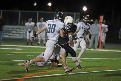 Two division leaders prevail, other locals struggle in HS football Week 4