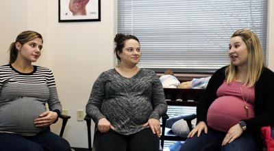 Moms-to-be teach each other in monthly group visits
