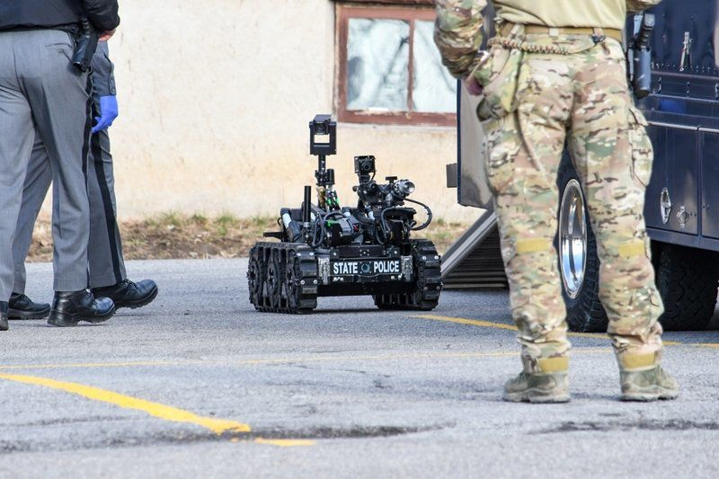 Confrontation with troopers leads to bomb probe at Falls apartment