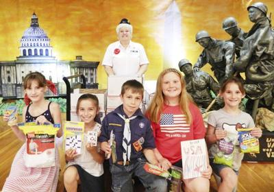 R-H kids fill boxes for military