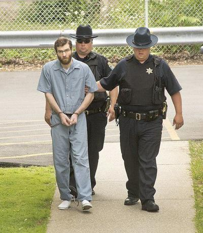 Accused killer Roy is returned to court