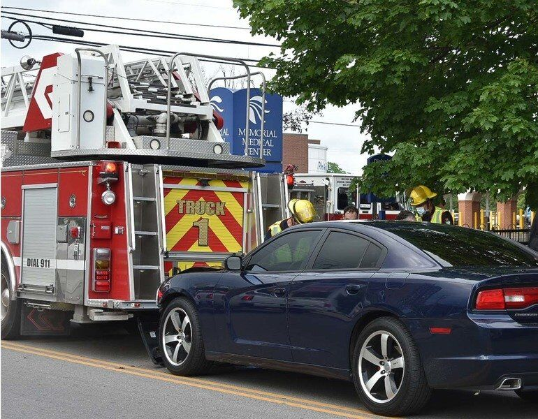 Woman faces charges after driving intoFalls fire truck