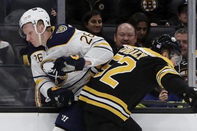 Marchand, Pastrnak lead Boston past struggling Sabres