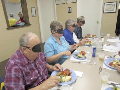 Barker Lions experience 'Dining in the Dark'