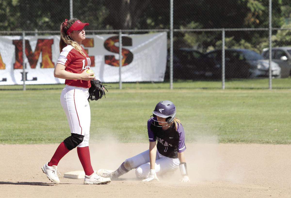 High school softball: Flames' bats too hot for Tigers