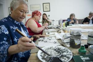 Inking orchids and bamboo at the Lodi Community Art Center