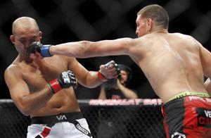 Nick Diaz pummels B.J. Penn, gets shot at George St. Pierre
