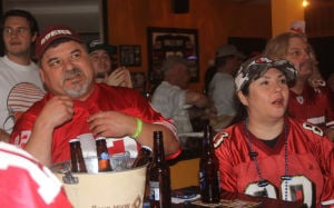 San Francisco 49ers Fans' Emotions Went Up And Down During Super Bowl: Lodi residents Terry Lanza, left, and Jeana Garabrant show excitement at the end of the first quarter of the Super Bowl on Sunday, Feb. 3, 2013.  - Ross Farrow/News-Sentinel