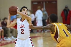 Boys basketball: Flames fend off Bulldogs