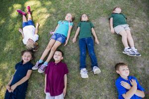 Vinewood Elementary School students give bikram yoga a try