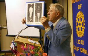 Rotary speaker Ted Robinson remembers Navy years with John F. Kennedy