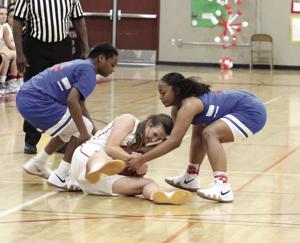 Girls basketball: Flames fall in tournament title game